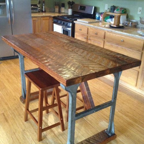 Dining Island with Antique Cast Iron Legs and Antique Reclaimed Wood Top