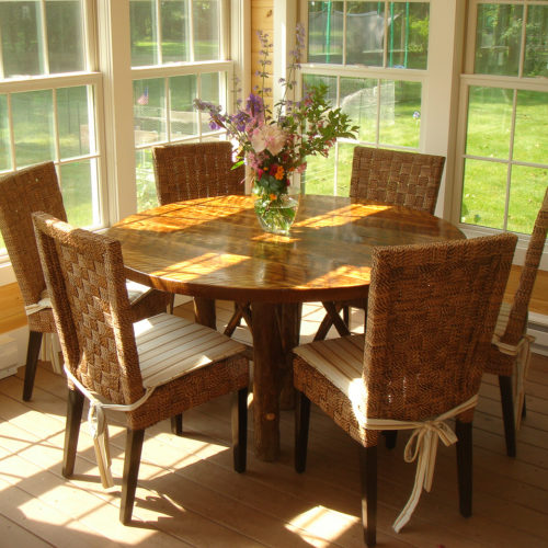 Round Dining Table in Rough Sawn Oak with Medium Stain