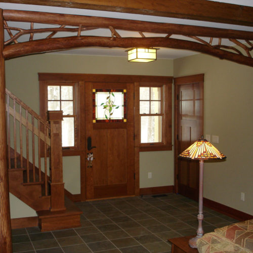 Hickory Log Posts with Peeled Hardwood Arch and Twig Infill